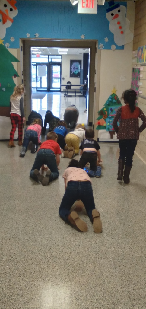 2nd Grade Class Measuring Down the Hallway