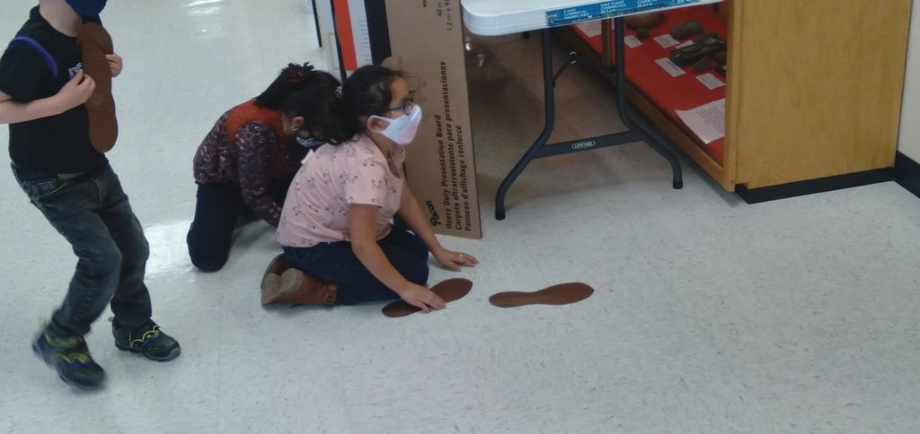 "Aly  and Fabiola measuring with ""teacher feet"""