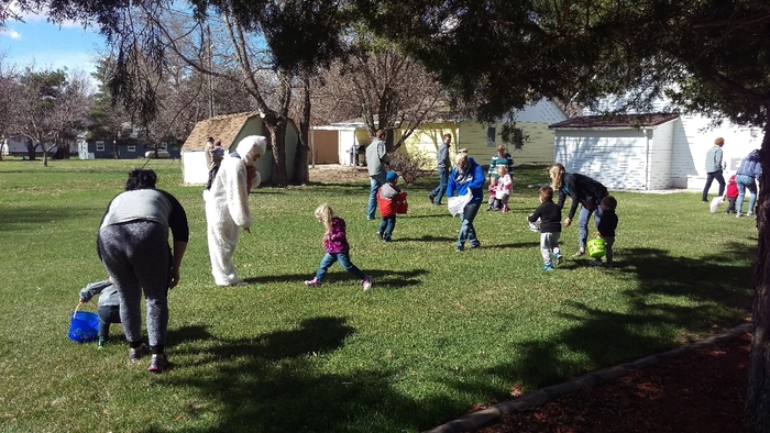 preschoolers hunting Easter eggs with the Easter Bunny
