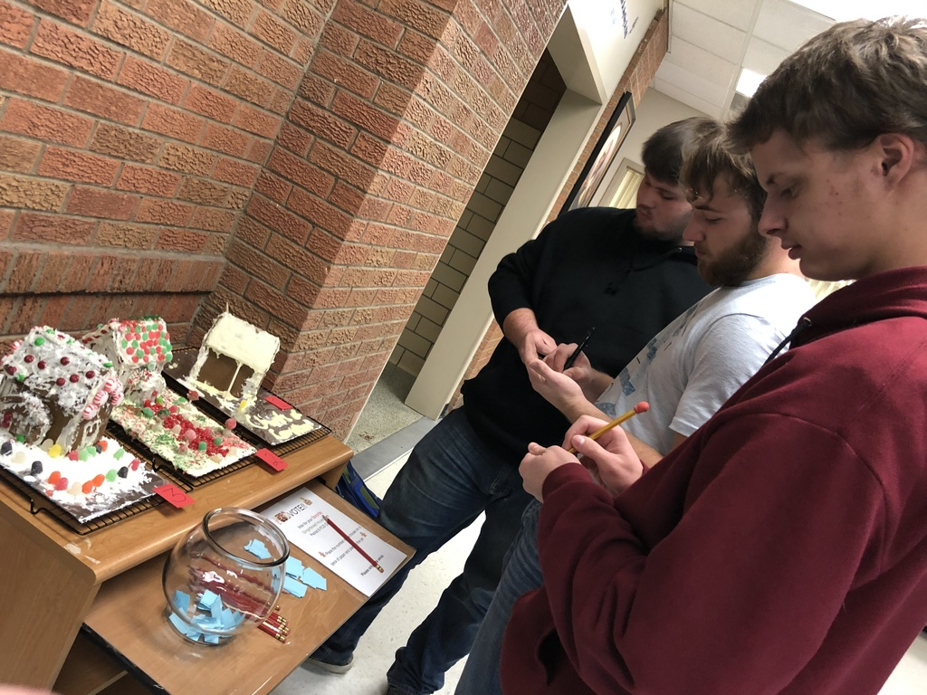 The three gingerbread houses created by the FCS class, voting for favorites